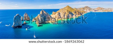 Aerial panoramic view of Lands End and El Arco at the tip of Baja California Sur, with the Cabo San Lucas, Mexico marina in the background Royalty-Free Stock Photo #1869263062