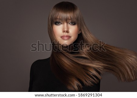 Beautiful model woman with shiny and straight long hair. Keratin straightening. Treatment, care and spa procedures. Beauty girl smooth hairstyle Royalty-Free Stock Photo #1869291304
