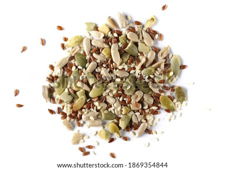 Pile mix seeds, sunflower, sesame, linseed and pumpkin seed isolated on white background, top view Royalty-Free Stock Photo #1869354844