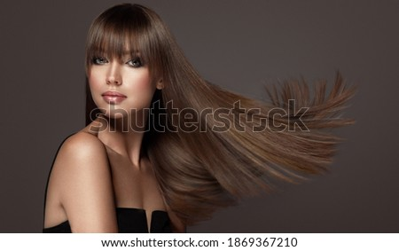 Beautiful model woman with shiny and straight long hair. Keratin straightening. Treatment, care and spa procedures. Beauty girl smooth hairstyle Royalty-Free Stock Photo #1869367210