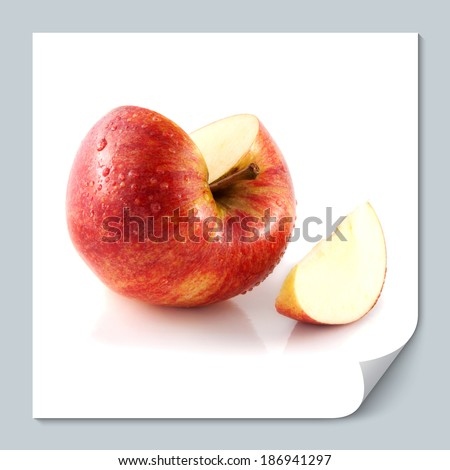 Isolated sliced red apple with one slice (wet). Fresh diet apple. Healthy fruit with vitamins.