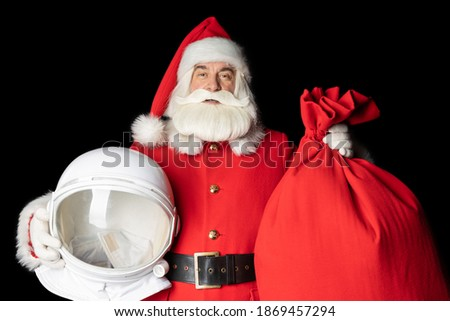 Space Santa Claus arrived for Christmas. Close-up on a black background.