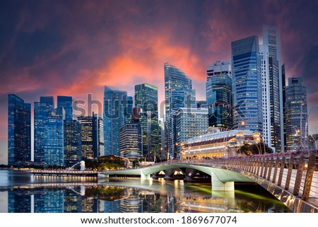 Stunning view of the Singapore's skyline illuminated at sunset during the Covid-19 pandemic. Singapore is a sovereign island city-state in maritime Southeast Asia. Royalty-Free Stock Photo #1869677074