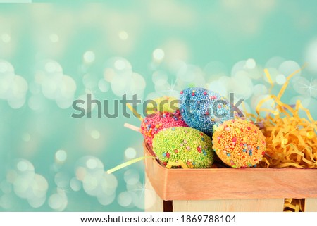 banner Easter eggs in egg cartoon box on blue background close up. Festive decorations. Happy Easter.