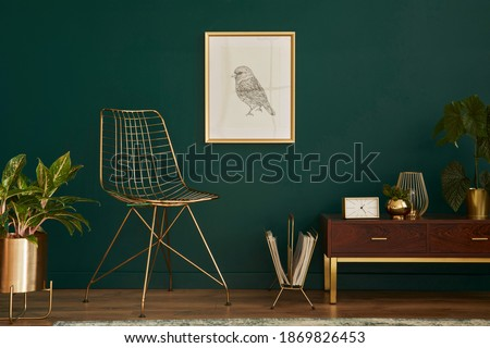 Luxury interior with stylish chair, wooden commode, mock up poster frame, plants, carpet, gold decoration and elegant personal accessories. Modern living room in classic house. Template. Royalty-Free Stock Photo #1869826453