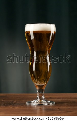 Glass beer on wood background with copyspace  #186986564