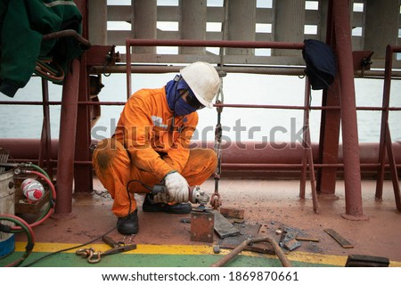 Crew Fixing Repairing Working Mother Vessel Deck Royalty-Free Stock Photo #1869870661