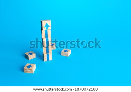 Block tower with arrows. Business growth and development concept. Achieve success. Building career advancement, improving skills. Goal achievement. Progress and movement forward. Self improvement Royalty-Free Stock Photo #1870072180