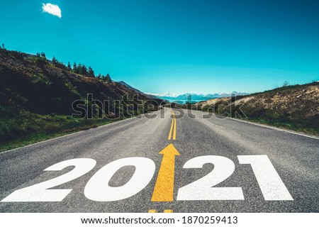 2021 New Year road trip travel and future vision concept . Nature landscape with highway road leading forward to happy new year celebration in the beginning of 2021 for fresh and successful start . #1870259413