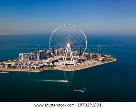 Bluewaters island and Ain Dubai ferris wheel on in Dubai, United Arab Emirates aerial view. New leisure and residential area in Dubai marina area Royalty-Free Stock Photo #1870291891
