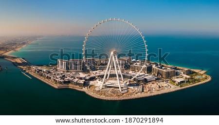 Bluewaters island and Ain Dubai ferris wheel on in Dubai, United Arab Emirates aerial view. New leisure and residential area in Dubai marina area Royalty-Free Stock Photo #1870291894