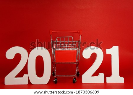 2021 Shopping Cart on Red background - new year 2021 - Business Shopping stores to buy goods concept - Black Friday Deal   #1870306609