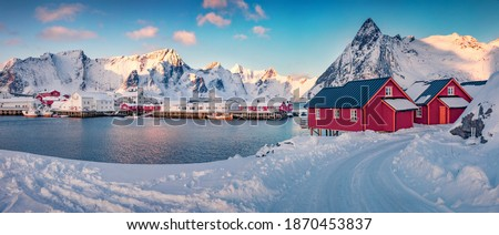 Landscape photography. Panoramic winter cityscape of small fishing town - Hamnoy, Norway, Europe. Splendid morning seascape of Norwegian sea. Landscape of Lofoten Island with snowy country road