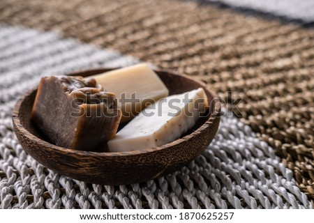 Natural eco friendly solid shampoo bar, conditioner or soap laying on wooden background. Zero waste and sustainable plastic free lifestyle concept Royalty-Free Stock Photo #1870625257