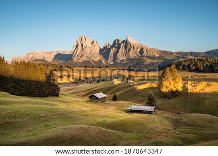 Alpe di Siusi at sunset on a clear summer day, Dolomites, Italy, Europe. Seiser Alm is a Dolomite plateau and the largest high-altitude Alpine meadow in Europe. Royalty-Free Stock Photo #1870643347