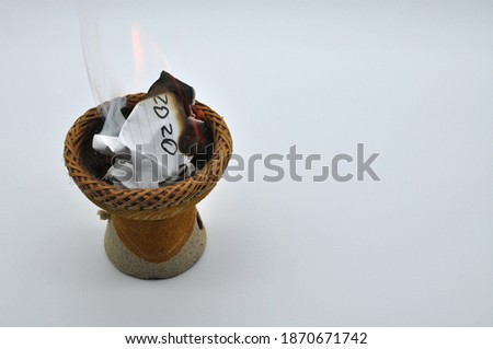 Let's take this 2020 year and set it on fire, so let's hope 2021 will be better. Conceptual photo represented burning a sheet of paper with Bye 2020