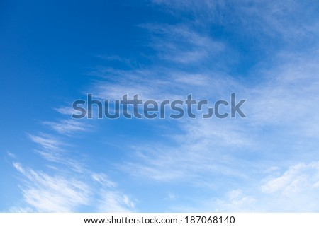 Background with white windy clouds on the blue sky #187068140