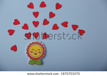 sun and hearts on a blue background