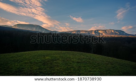 Mountain landscape, hillside against the background of mountains in the morning. Spring season, March. Background for design. Crimea. Ukraine. Europe.