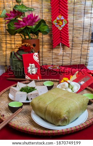 Amazing Vietnamese cuisine for the Tet holidays in the spring, this is traditional cuisine for the lunar new year: Banh lung, boiled chicken, pickled onions, spring rolls ... Royalty-Free Stock Photo #1870749199