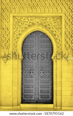 Arabic oriental styled door in Morocco. Illuminating and Ultimate gray Pantone color of the year 2021 Royalty-Free Stock Photo #1870795162