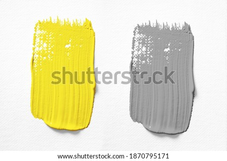 Illuminating and Ultimate gray Pantone color of the year 2021 oil paint stroke on white background  Royalty-Free Stock Photo #1870795171