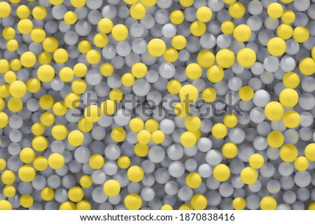 Illuminating yellow and Ultimate Gray balls background. Color year 2021. Abstract backdrop, close-up. Royalty-Free Stock Photo #1870838416