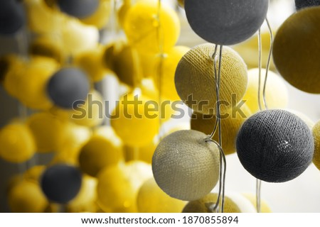 Illuminating and Ultimate gray Pantone color of the year 2021 light ball made from folding cotton yarn
