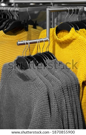 Illuminating and Ultimate gray Pantone color of the year 2021 winter sweater on store shelves