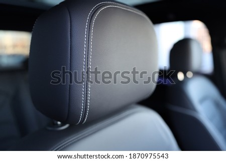 The headrest of the car. Leather headrest in black color Royalty-Free Stock Photo #1870975543