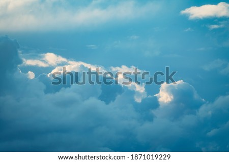 Thunderstorm cloud in the sky at sunset texture background. Blue abstract shades. True high resolution photography
