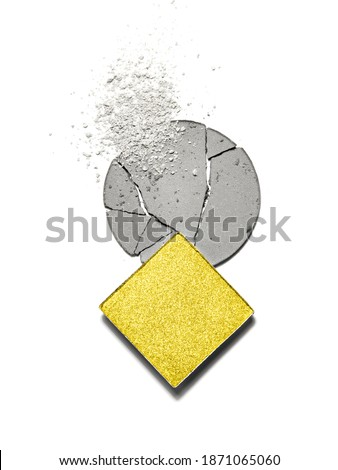 Broken square and round eyeshadows and scattered makeup of main colour trend of the year. Close up of trendy coloured cosmetics. Color of the year 2021illuminating and ultimate gray background.