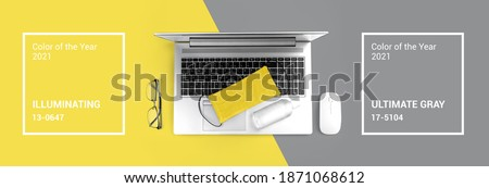 Office computer gadget on Ultimate Gray and Illuminating yellow background. Color of the year 2021. Hygiene banner with protective medical mask, sanitizer. Virus protection stay home remote work Royalty-Free Stock Photo #1871068612