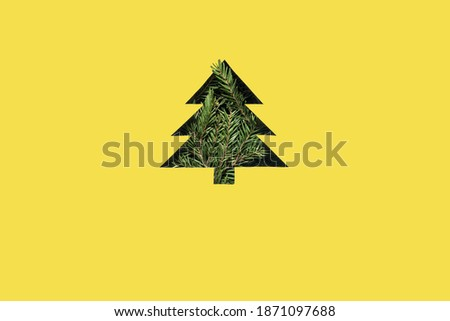 Happy new year and Christmas greeting card in trendy colors. Yellow and gray colors of the year 2021. Christmas Tree cut out of paper