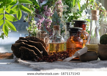 Witchcraft. Magic potions on the witch doctor table. Royalty-Free Stock Photo #1871171143