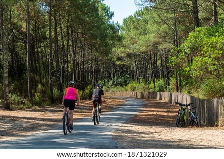 Arcachon Bay, France. Bike path in the Gascony forest near the dune of Pilat in La Teste Royalty-Free Stock Photo #1871321029
