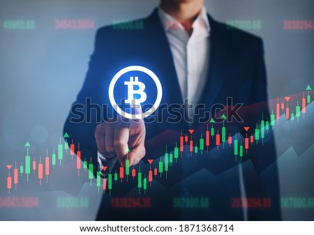 Businessman pointing digital bitcoin icon. Concept of the  rise in prices for bitcoin. Increase in value of cryptocurrencies. Futuristic stock exchange.