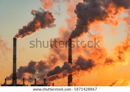 Aerial view of high smoke stack with smoke emission. Plant pipes pollute atmosphere. Industrial factory pollution, smokestack exhaust gases. Industry zone, thick smoke plumes. Climate change, ecology Royalty-Free Stock Photo #1871428867