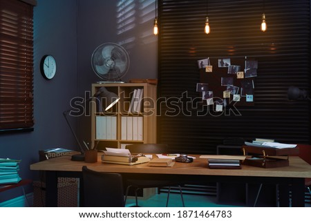 Detective office interior with evidence board on wall Royalty-Free Stock Photo #1871464783
