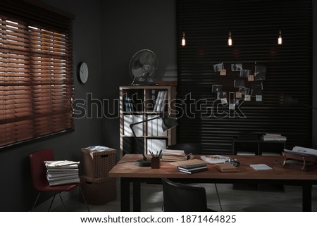 Detective office interior with evidence board on wall Royalty-Free Stock Photo #1871464825