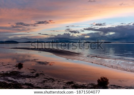 peaceful sunset colorful sky reflection on the sea  Royalty-Free Stock Photo #1871504077