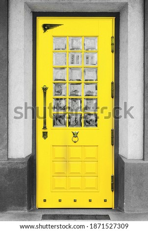 The classical architecture of the Mediterranean (Greece, Italy, Spain, Cyprus, Portugal). Wooden yellow door on the white buildings. Illuminating and Ultimate gray Pantone color of the year 2021