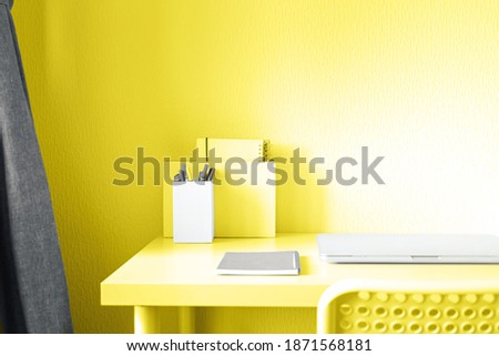 Trendy colors of 2021 - Illuminating Yellow and Ultimate Gray toned image. Home work or office background. Workspace with table and laptop, nobody