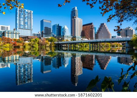 Perfect mirrored reflections over town lake aerial drone views with Perfect Loop Fall Colors and a Growing Austin Texas Cityscape Skyline Capital City