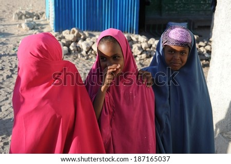 HARGEISA, SOMALIA - JANUARY 8, 2010:Unidentified Somalis in the streets of the city of Hargeysa. City in Somalia, capital of unrecognized state of Somaliland. Much of the population lives in poverty. #187165037
