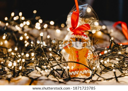 New Year's background with elements of the festive lights, Christmas ornaments: gingerbread with the image of a medical mask on the face