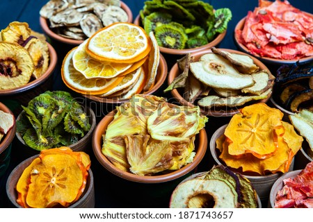 Organic Healthy Assorted Dried Fruit Mix close up. Dried fruit snacks. dried apples, mango, feijoa, dried apricots, prunes top view Royalty-Free Stock Photo #1871743657