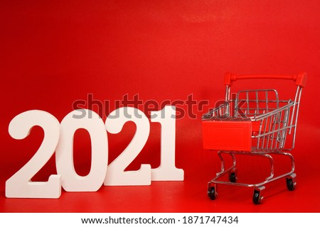 Mockup 2021 Shopping Cart on Red background - new year 2021 - Business Shopping stores to buy goods concept  #1871747434