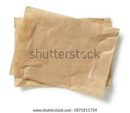 crumpled brown baking paper sheets isolated on white background, top view Royalty-Free Stock Photo #1871811724