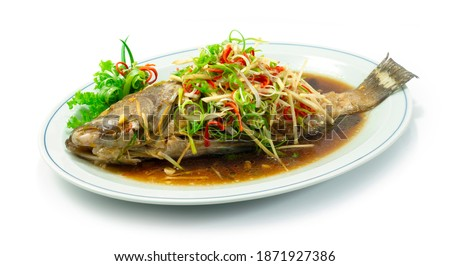 Steamed Grouper Fish with Soy Sauce Chinese food Style sideview Royalty-Free Stock Photo #1871927386